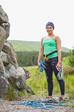 Attractive rock climber smiling at camera
