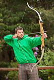 Focused man practicing archery