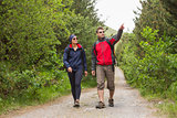 Couple going on a hike together with man pointing