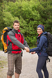 Loving couple going on a hike together holding hands