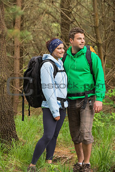 Smiling couple standing in a forest