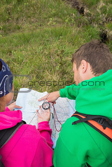 Couple using map and compass