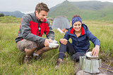 Couple cooking outside on camping trip