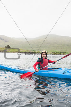 Happy woman in a kayak