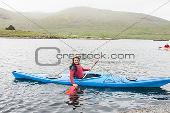 Smiling woman in a kayak