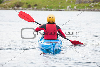 Woman rowing in a kayak