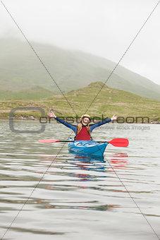 Blonde woman in a kayak