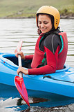Fit woman rowing on lake
