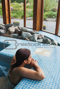 Brunette relaxing in a jacuzzi