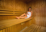 Calm brunette relaxing in a sauna