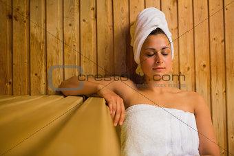 Calm woman relaxing in a sauna