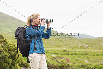 Blonde on a hike taking a photo