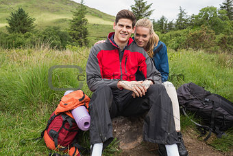 Happy couple taking a break on a hike