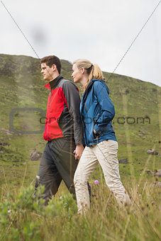 Cheerful couple walking through the countryside
