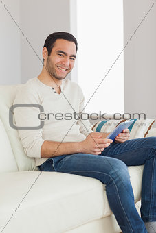Smiling handsome man using his tablet