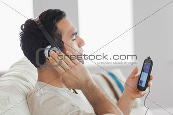 Content handsome man listening to music