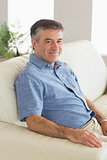 Smiling man sitting on a sofa
