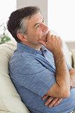 Thinking man sitting on sofa