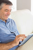 Smiling man using a tablet pc