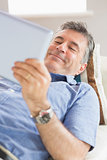 Happy man using a tablet pc