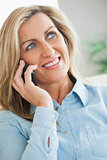 Smiling woman calling someome with her mobile phone
