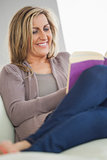 Smiling woman reading a book