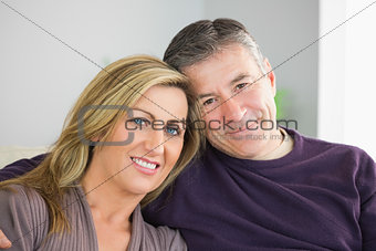 Smiling couple looking at camera
