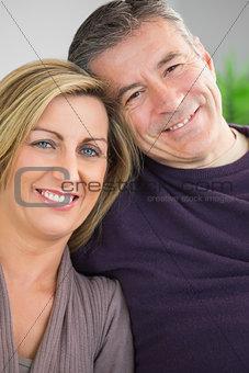 Happy couple looking at camera