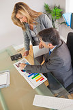 Two business people looking at documents in an office