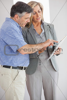 Estate agent explaining lease to customer