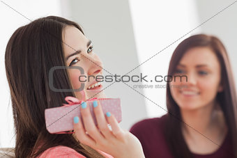 Smiling girl holding a present
