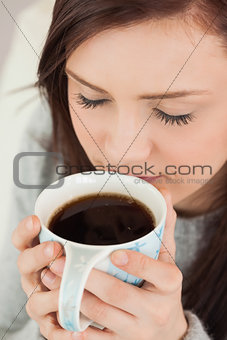 Relaxed girl drinking a cup of coffee