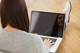 Girl using a laptop sitting on the floor