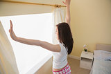 Girl stretching in a bedroom