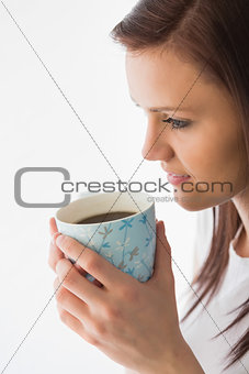 Thoughtful girl drinking a cup of coffee