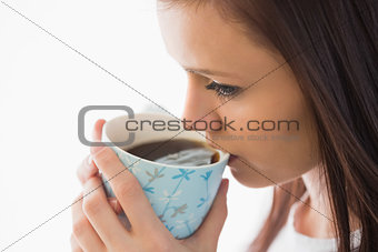 Calm girl drinking a cup of coffee