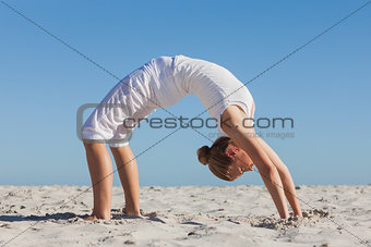 Woman doing crab yoga pose