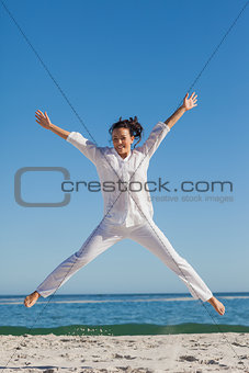 Smiling woman jumping up