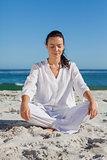 Beautiful woman sitting on sand