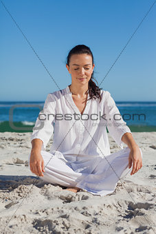 Beautiful woman sitting on sand