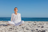 Peaceful woman sitting and relaxing