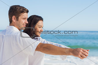 Romantic couple relaxing on the beach