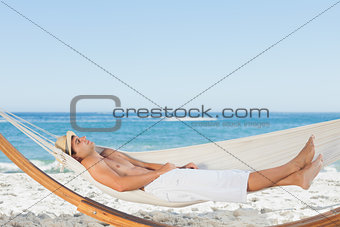 Handsome man relaxing in a hammock