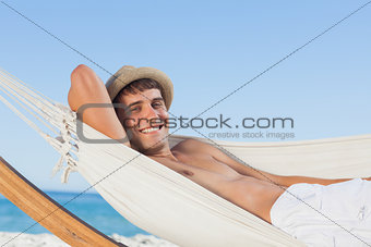 Smiling man wearing straw hat looking at camera