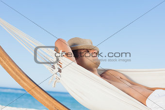 Man lying on hammock sleeping