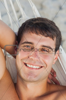 Attractive man lying in hammock
