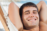 Smiling man relaxing in hammock