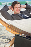 Businessman relaxing in a hammock