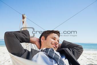 Businessman relaxing in hammock