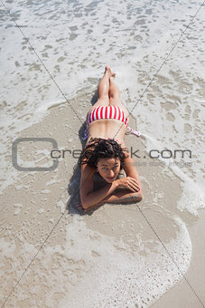 High angle view of woman lying down on beach